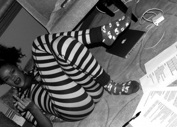 rihanna in her black and white stripy onesey